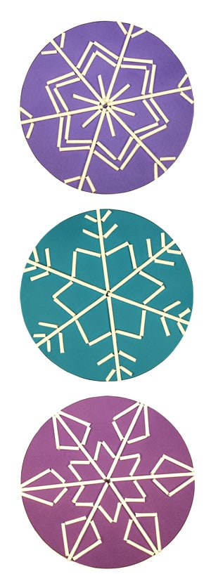 Three snowflakes made with lollipop sticks